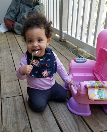 Chewing on Spoon on Patio