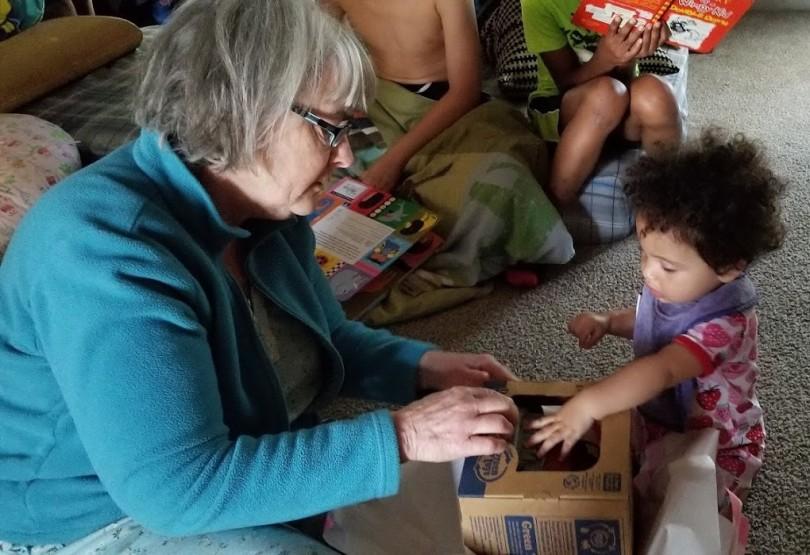 Maddie & Grandma Opening Present